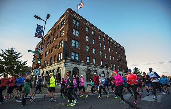Competitors in the Kansas half marathon turn the corner at 7th and Massachusetts Street, running past the historic Eldridge Hotel in November 2014.