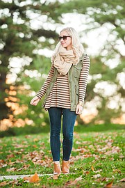 Elizabeth Kennedy takes pieces, such as a pair of skinny jeans, ankle boots and a vest, that can be worn during other seasons and layers them together to make a fall outfit.
