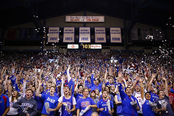 The Kansas student section explodes prior to tipoff against Washburn as Jayhawk basketball season begins on Monday, Nov. 3, 2014 at Allen Fieldhouse.