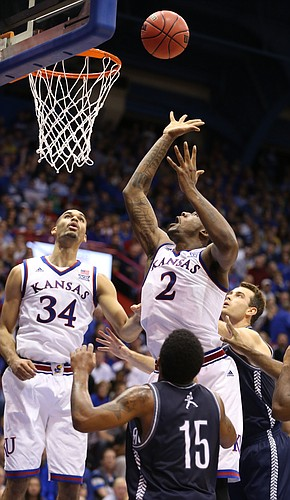 Kansas forward Cliff Alexander tosses up a shot between Washburn defenders Kevin House and Alex North during the first half on Monday, Nov. 3, 2014 at Allen Fieldhouse. At left is KU forward Perry Ellis.