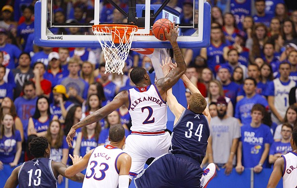 Kansas forward Cliff Alexander pins a shot by Washburn forward Jeremy Licktieg against the glass during the second half on Monday, Nov. 3, 2014 at Allen Fieldhouse. Alexander was called for a foul on the play.