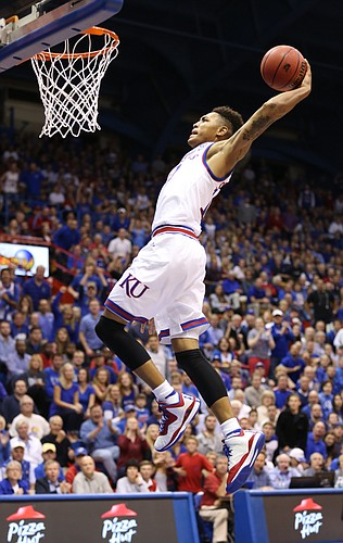 Kansas guard Kelly Oubre pulls back on a breakaway dunk against Washburn during the second half on Monday, Nov. 3, 2014 at Allen Fieldhouse.