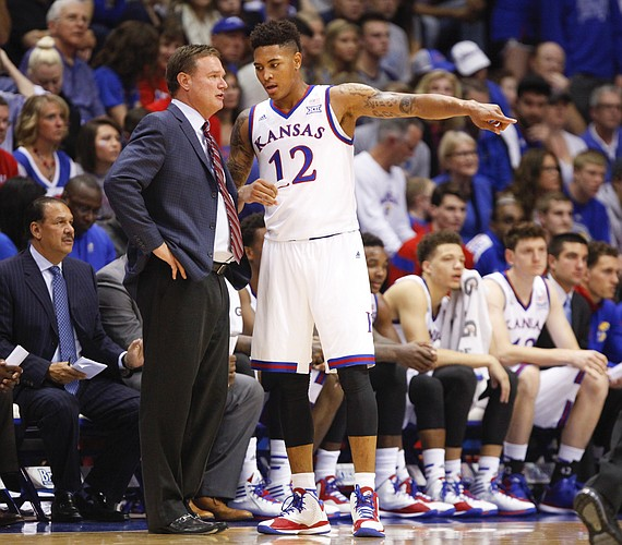Kansas head coach Bill Self and guard Kelly Oubre have a chat on the sideline during the first half on Monday, Nov. 3, 2014 at Allen Fieldhouse.