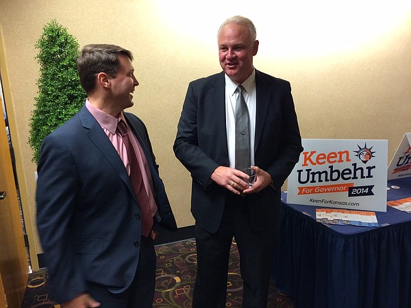 Libertarian candidate for Kansas governor Keen Umbehr, right, waits for results at his campaign's watch party, Tuesday, Nov. 4, 2014, in Topeka.