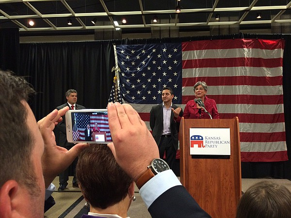 Attendees at the Kansas Republican Party watch party listen to a speech by State Sen. Susan Wagle, Tuesday, Nov. 4, 2014, in Topeka.