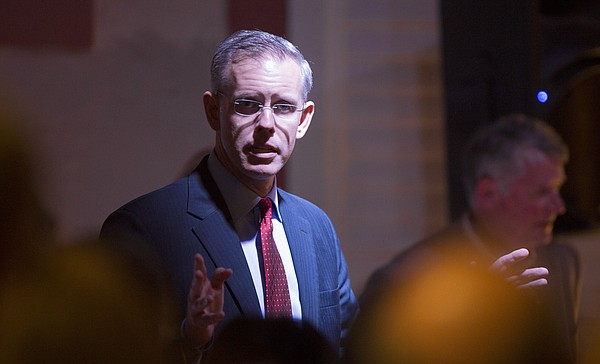 Democratic gubernatorial candidate Paul Davis speaks in a private meeting with his supporters on Nov. 4, 2014, at Abe & Jake's Landing in Lawrence.