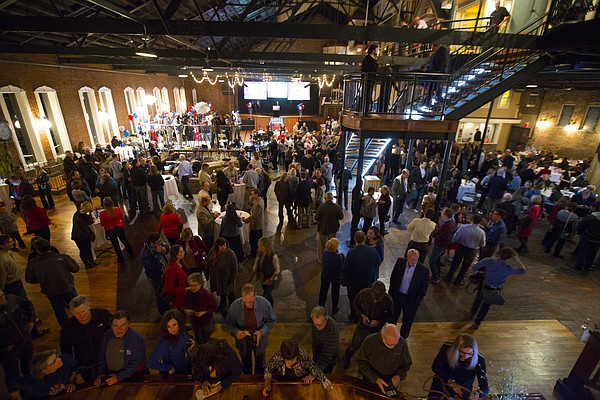 Supporters gather for the watch party for democratic gubernatorial candidate Paul Davis on Tuesday, Nov. 4, 2014 at Abe & Jake's Landing in Lawrence.