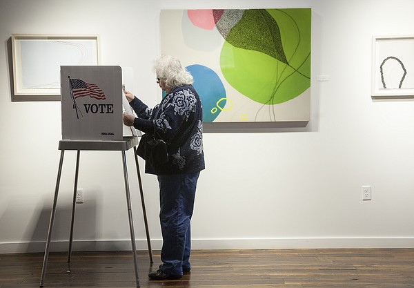 Clara Holladay completes her mid-term election ballot Tuesday morning at Precinct 39, located at the Cider Gallery, 810 Pennsylvania St.