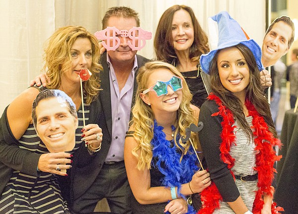 A group takes a silly picture in a photo booth at the Greg Orman election watch party Tuesday night, Nov. 4, 2014, at the Overland Park Convention Center in Overland Park.