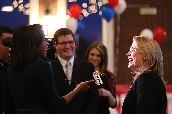 Jill Docking, lieutenant governor running mate for Paul Davis, laughs with media members as she is interviewed before the watch party for Davis on Tuesday, Nov. 4, 2014 at Abe & Jake's Landing in Lawrence.