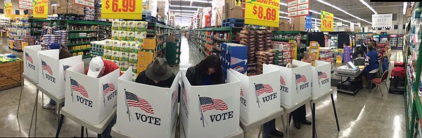 Voters cast their ballots early on Election Day at Checkers grocery store at 23rd and Louisiana in Lawrence.