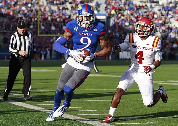 Kansas receiver Nigel King is forced out of bounds after a catch against Iowa State defensive back Sam Richardson during the second quarter on Saturday, Nov. 8, 2014.