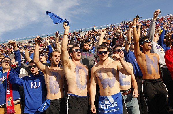"A line of Kansas students painted with letters spelling out ""Bowen"" cheer during a kickoff after Kansas touchdown against Iowa State during the first quarter on Saturday, Nov. 8, 2014."
