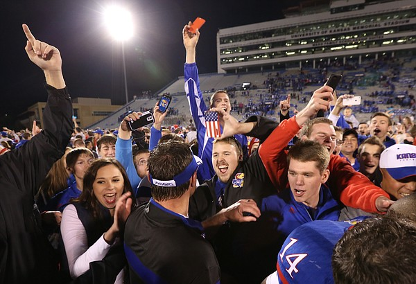 Kansas football fans cheer interim head coach Clint Bowen as he leaves the field following the Jayhawks' 34-14 win over the Cyclones on Saturday, Nov. 8, 2014.