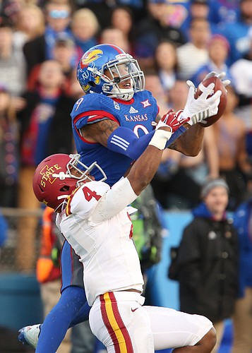 Kansas receiver Nigel King gets high over Iowa State defensive back Sam Richardson for a deep catch during the third quarter on Saturday, Nov. 8, 2014.