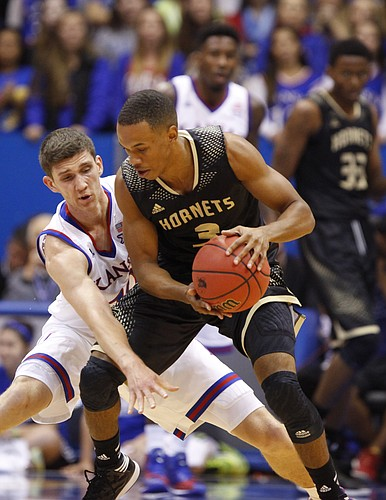 Kansas guard Sviatoslav Mykhailiuk defends against Emporia State guard Tyler Jordan during the first half on Tuesday, Nov. 11, 2014.