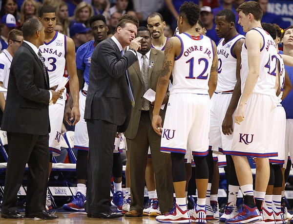 Kansas head coach Bill Self has words for Kelly Oubre during a team huddle during the first half on Tuesday, Nov. 11, 2014.