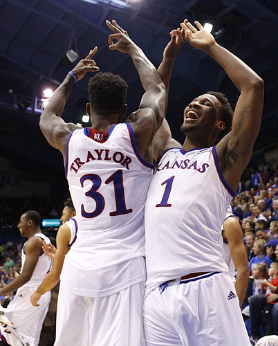 Kansas teammates Wayne Selden (1) and Jamari Traylor (31) celebrate a three pointer from reserve Evan Manning against Emporia State during the second half on Tuesday, Nov. 11, 2014.