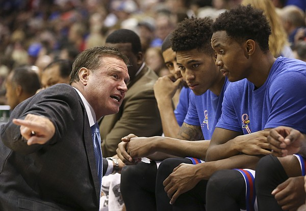 Kansas head coach Bill Self takes a knee to talk with some of the freshman during the second half on Tuesday, Nov. 11, 2014.