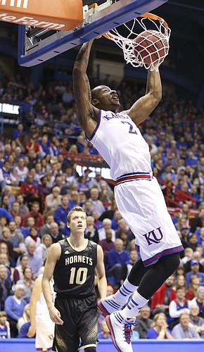 Kansas forward Cliff Alexander delivers on a dunk past Emporia State guard Jay Temaat during the second half on Tuesday, Nov. 11, 2014.