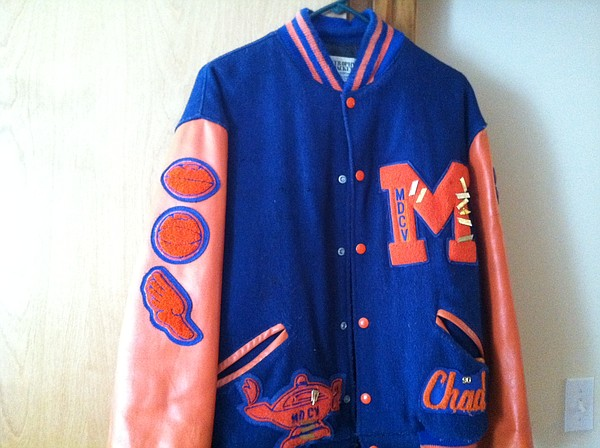 A Marais des Cygnes Valley Trojan letter jacket. Note that the medals have been removed to preserve the integrity of the plastic coat hanger.