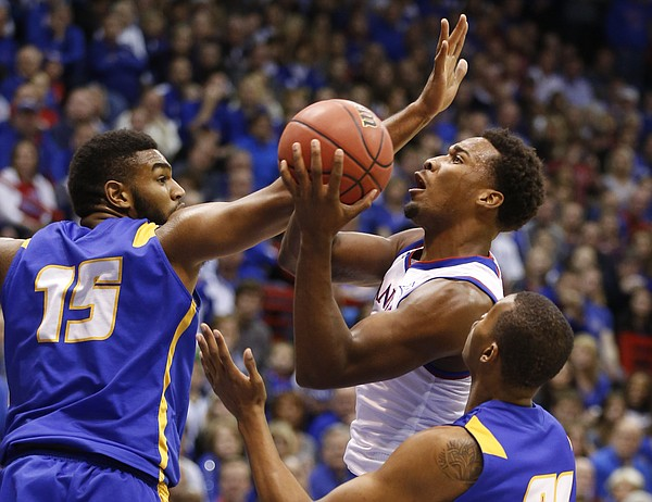 Kansas guard Wayne Selden gets to the bucket between UC Santa Barbara defenders John Green (31) and Alan Williams (15) during the first half on Friday, Nov. 14, 2014 at Allen Fieldhouse.