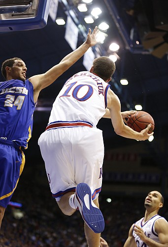 Kansas guard Sviatoslav Mykhailiuk gets under UC Santa Barbara defender Michael Bryson on his way to the  bucket during the second half on Friday, Nov. 14, 2014 at Allen Fieldhouse.