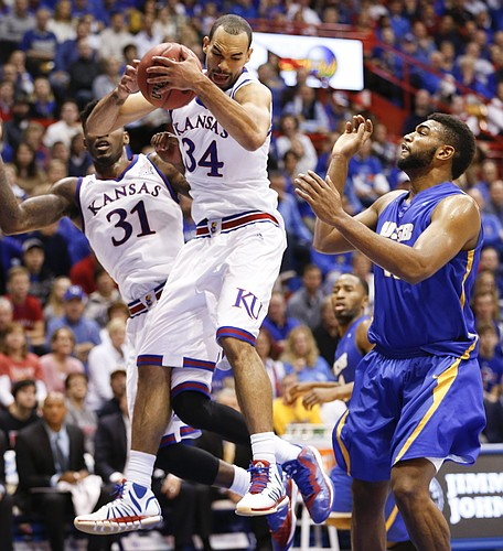 Kansas forward Perry Ellis pulls away a rebound from UC Santa Barbara player Alan Williams during the first half on Friday, Nov. 14, 2014 at Allen Fieldhouse.