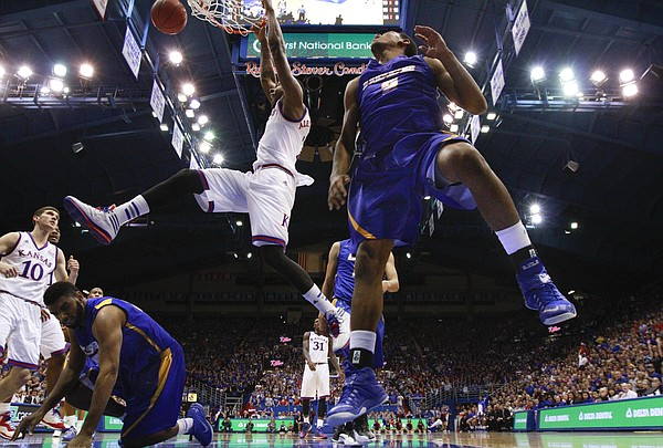 Kansas forward Cliff Alexander delivers a jam against UC Santa Barbara players Gabe Vincent (2) and Alan Williams during the second half on Friday, Nov. 14, 2014 at Allen Fieldhouse.