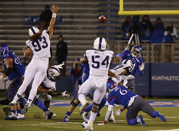Kansas quarterback Michael Cummings throws over the TCU defense during the fourth quarter on Saturday, Nov. 15, 2014 at Memorial Stadium.