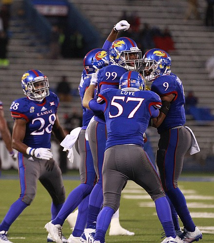 Kansas defensive lineman Tedarian Johnson is surrounded by teammates after recovering a fumble by TCU during the fourth quarter on Saturday, Nov. 15, 2014 at Memorial Stadium.