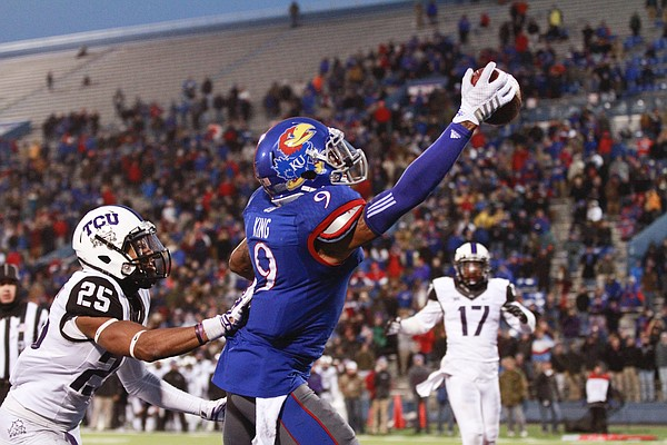 Kansas receiver Nigel King one-hands an end zone pass that was ruled out of bounds during the fourth quarter on Saturday, Nov. 15, 2014 at Memorial Stadium.