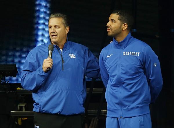 Kentucky coach John Calipari, left, and hip-hop star Drake speak during the team's NCAA college basketball Big Blue Madness, Friday, Oct. 17, 2014, in Lexington, Ky. (AP Photo/James Crisp)