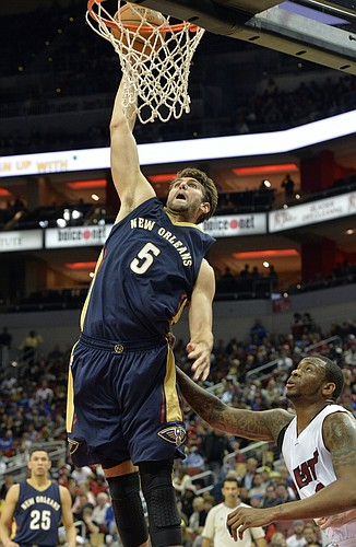 New Orleans Pelicans' Jeff Withey (5) dunks over the defense of Miami Heat's Shawn Jones during the fourth quarter of an NBA basketball preseason game in Louisville, Ky., Saturday, Oct. 4, 2014. New Orleans defeated Miami 98-86. (AP Photo/Timothy D. Easley)