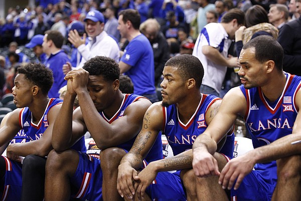 Kansas players Devonte Graham, left, Wayne Selden, Frank Mason and Perry Ellis watch during the final seconds of the Jayhawks' 72-40 loss to Kentucky during the Champions Classic on Tuesday, Nov. 18, 2014 at Bankers Life Fieldhouse in Indianapolis.