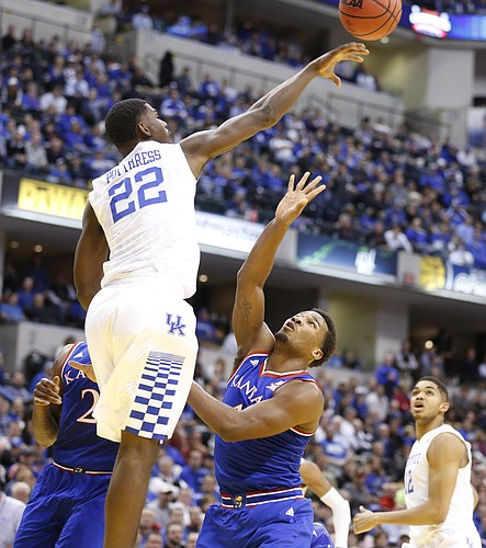 Kansas guard Wayne Selden Jr. (1) watches as Kentucky forward Alex Poythress (22) rejects his floater during the second half of the Champions Classic on Tuesday, Nov. 18, 2014 at Bankers Life Fieldhouse in Indianapolis.
