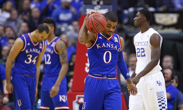 Kansas guard Frank Mason III (0) give the ball a hard bounce in frustration after a string of Jayhawk fouls during the first half of the Champions Classic on Tuesday, Nov. 18, 2014 at Bankers Life Fieldhouse in Indianapolis.