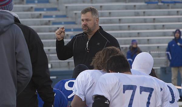Former KU standout center Chip Budde was on hand at Wednesday's KU football practice to give a pep talk to players as the Jayhawks prepare to travel to Oklahoma to play the Sooners.