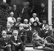Seated at center, with white hair and black skirt, is Louise Gates Roberts Rouselaux, photographed with a group of early Lawrence settlers who had survived an 1856 raid on Lawrence as well as Quantrill's Raid in 1863. Reclining at lower right is Hugh 'Kansas Hermit' Cameron.