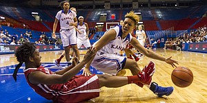 Kansas senior guard Asia Boyd, right, looks back in frustration after being whistled for a charge against Alabama sophomore forward Ashley Williams during the first game of the 2014 Naismith Hall of Fame Women's Challenge Friday evening at Allen Fieldhouse. Despite a 30 point performance by senior forward Chelsea Gardner, the Jayhawks were unable to hold off the Crimson Tide, falling 85-80. The Jayhawks will take the court again tomorrow for game two of the challenge against Temple. Tip off is set for 4 p.m. at Allen Fieldhouse.