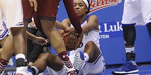 Kansas senior Chelsea Gardner (15) clutches th ball against Temple in the Jayhawks' 76-56 victory Saturday, Nov. 22, 2014, at Allen Fieldhouse.