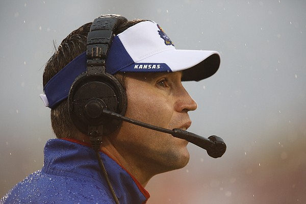 Kansas interim head coach Clint Bowen looks up at the scoreboard during the third quarter on Saturday, Nov. 22, 2014 at Memorial Stadium in Norman, Oklahoma.