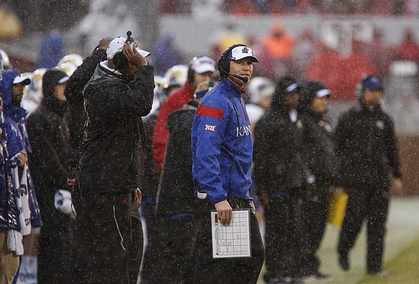 Rain pours down on interim head coach Clint Bowen as he watches an extra point by Oklahoma go through the uprights during the third quarter on Saturday, Nov. 22, 2014 at Memorial Stadium in Norman, Oklahoma.