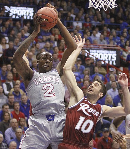 Kansas freshman Cliff Alexander collects a rebound against Rider's Anthony D'Orazio in KU's 87-60 win over Rider night at Allen Fieldhouse.