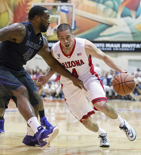 Arizona guard T.J. McConnell (4) attempts to drive past Kansas State forward Thomas Gipson (42) in the first half of an NCAA college basketball game at the Maui Invitational on Tuesday, Nov. 25, 2014, in Lahaina, Hawaii. (AP Photo/Eugene Tanner)
