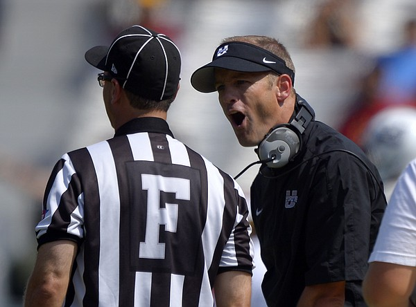 Utah State head coach Matt Wells, right, yells at a referee during the first half of an NCAA college football game against Southern California, Saturday, Sept. 21, 2013, in Los Angeles. (AP Photo/Mark J. Terrill)