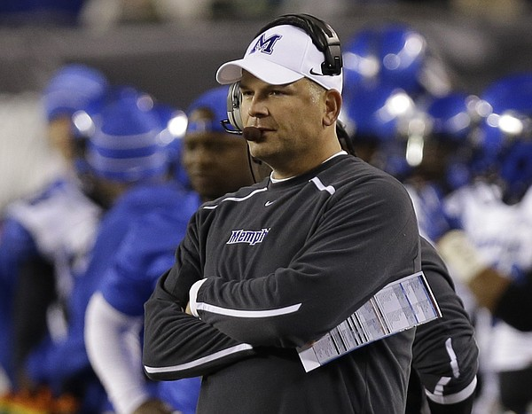 In this Oct. 4, 2014, file photo, Memphis coach Justin Fuente watches from the sideline in the first half of an NCAA college football game against Cincinnati in Cincinnati. Fuente said he saw plenty of potential in Memphis when he was hired to take over the program in December 2011. Now, his faith is being rewarded as Memphis could clinch at least a share of the American Athletic Conference title with a victory Saturday against Connecticut. (AP Photo/Al Behrman, File)