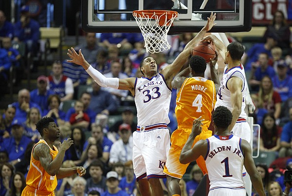 Kansas forward Landen Lucas (33) and forward Perry Ellis look to smother a shot from Tennessee forward Armani Moore (4) during the first half on Friday, Nov. 28, 2014 at the HP Field House in Kissimmee, Florida.
