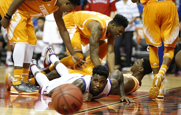 Tennessee players celebrate  a charge from Kansas forward Jamari Traylor during the second half on Friday, Nov. 28, 2014 at the HP Field House in Kissimmee, Florida.
