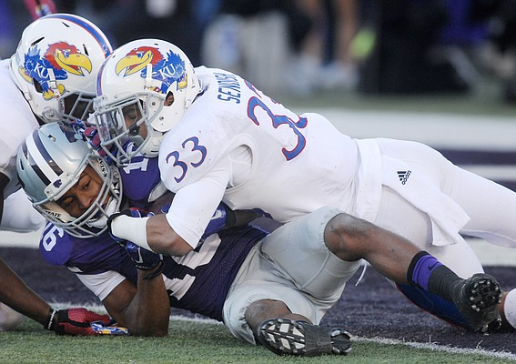 Kansas Cassius Sendish (33) tackles Wildcat receiver Tyler Locket shy of the goal line in the first-half of the Jayhawks game against the Kansas State Wildcats Saturday in Manhattan.